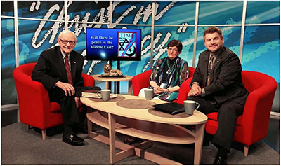 Jan Markell recording a television program with Dave Reagan and Nathan Jones